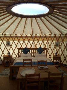 Step inside the yurt.