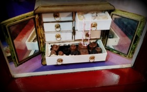 Decorative chocolate boxes from Victorian and Edwardian periods, which the lady had by her bedside and often stored jewellery after her booty of chocolates were over