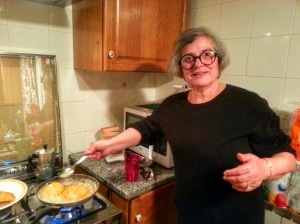Enza's mother, Caterina, frying a delicious dessert called seada that is essentially a cheese and honey pastry