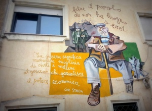 The murale that proclaims: 'Happy are the people who do not need heroes'