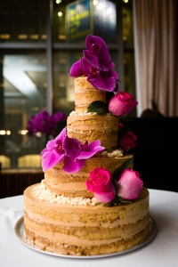 A four-tier Dulce de Leche naked cake by Momofuku